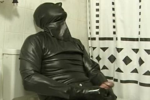 lad In darksome Latex Catsuit Jacks Off In bath