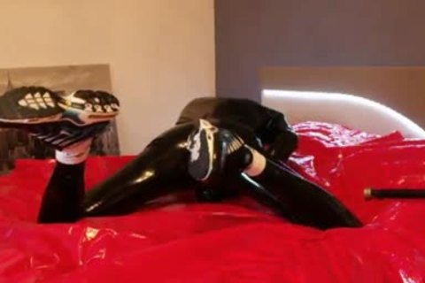 young stroking In darksome Latex lusty Very Very large penis