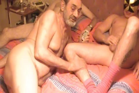 A naughty ready twink Is Serviced By two Daddies.in nature's garb.