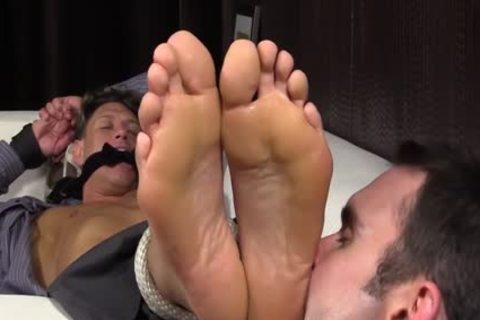 Bryce Evans Is fastened Up And Has His Toes Licked On The sofa
