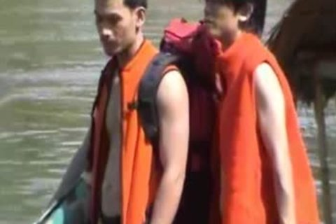 Thai dudes in nature's garb On A River