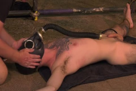 Roped Down twink receives A Gas Mask And A rough handjob